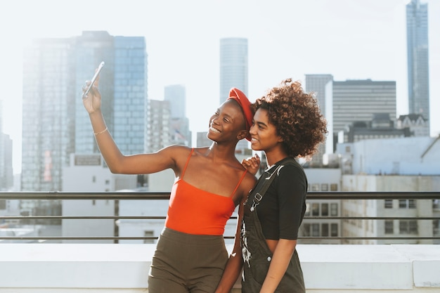 Girls taking a selfie at a rooftop Premium Photo