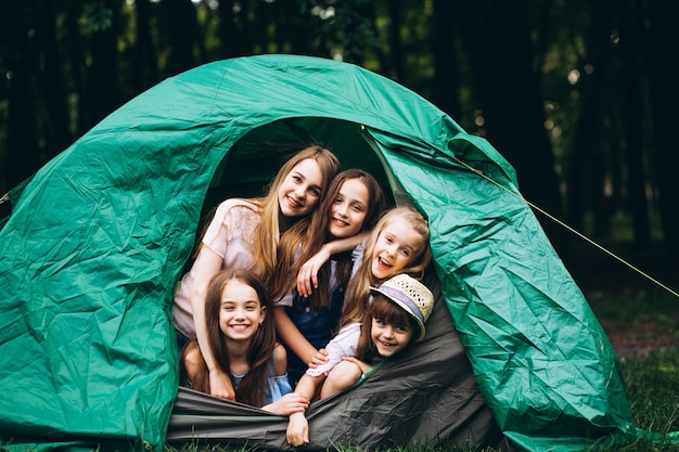 Girls in tent in forest Free Photo