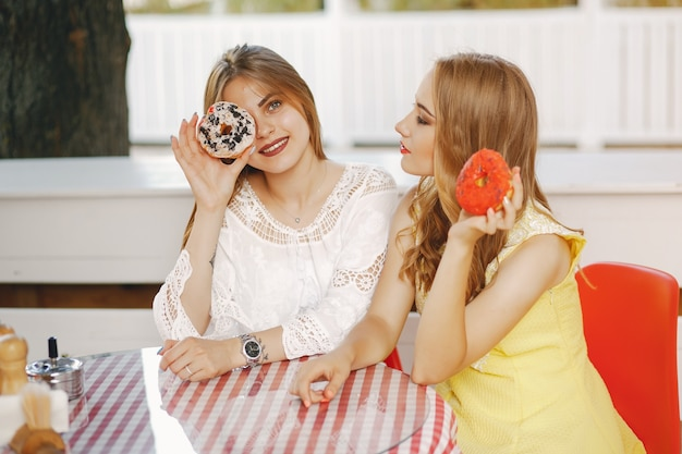 Girls with donut Free Photo