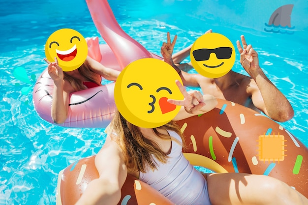 Girls with emoji faces being at the pool Free Photo