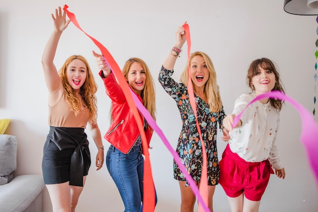 Girls with party ribbons Free Photo