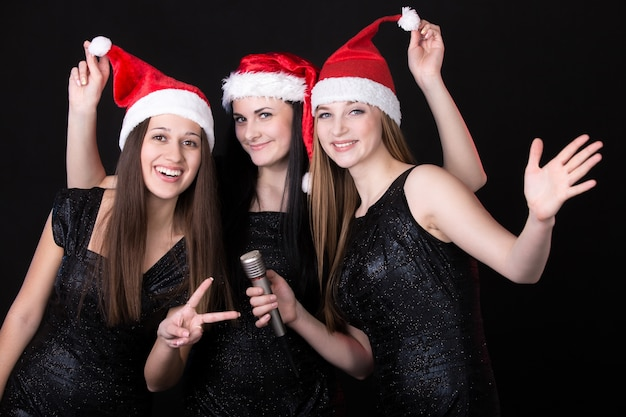 Girls with santa hat Free Photo