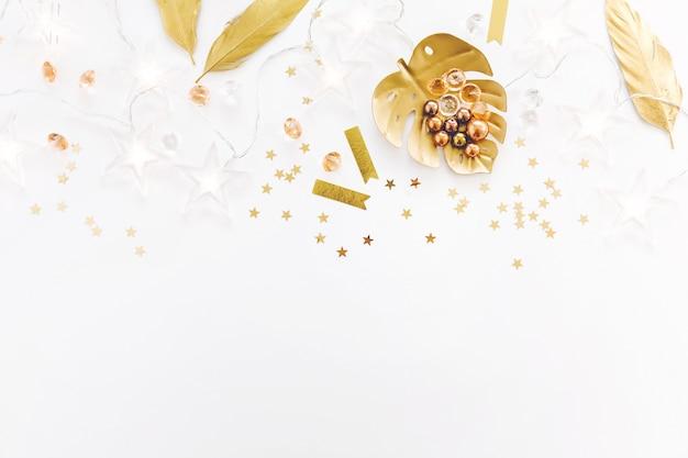 Girly feminine golden accessories on white Free Photo