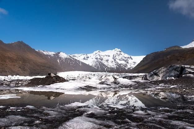 Glacier in iceland sunny day with reflection on the lake Premium Photo