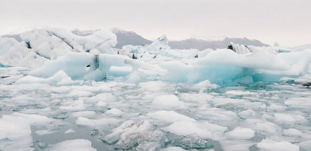 Glacier lake full of large blocks of ice. Premium Photo