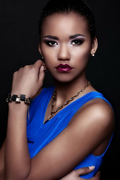 Glamor closeup portrait of beautiful sexy black young stylish woman model in blue dress with accessories with bright makeup  with perfect clean  skin Free Photo