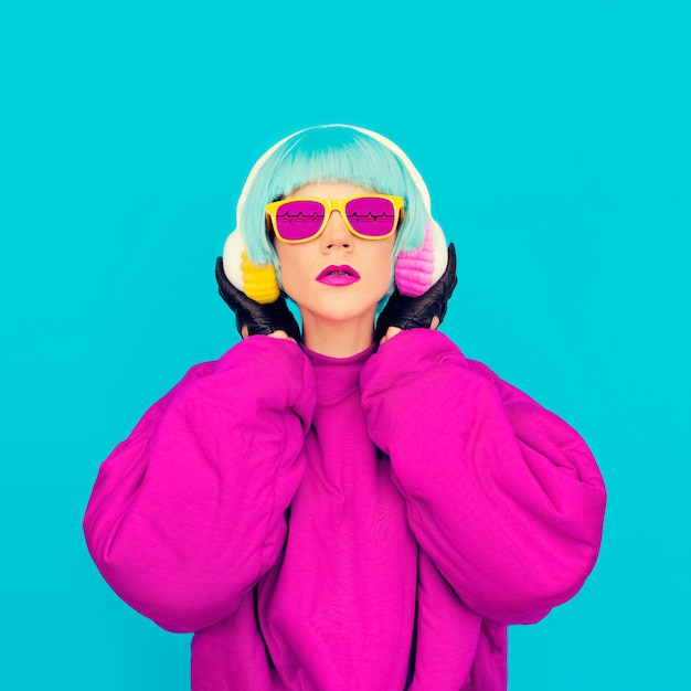 Glamorous fashion lady in bright clothes listening to music. all shades of music Premium Photo