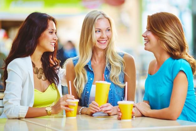 Glamorous women laughing Free Photo