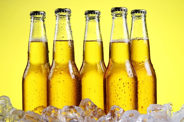 Glass of beer with foam on yellow background Free Photo