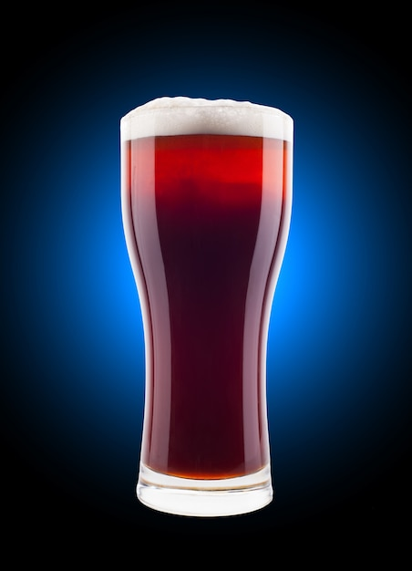 Glass of beer with foam Premium Photo