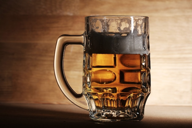 Glass of beer over wooden surface Free Photo