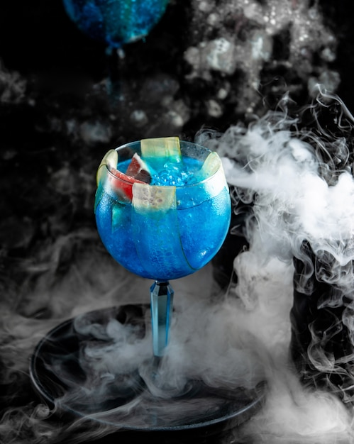 Glass of blue lagoon with berries Free Photo