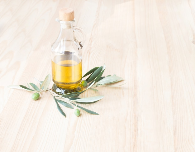 Glass bottle of olive oil. Free Photo