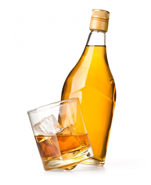 Glass and bottle of whiskey on a white Premium Photo