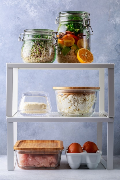 Glass boxes and cans with fresh food