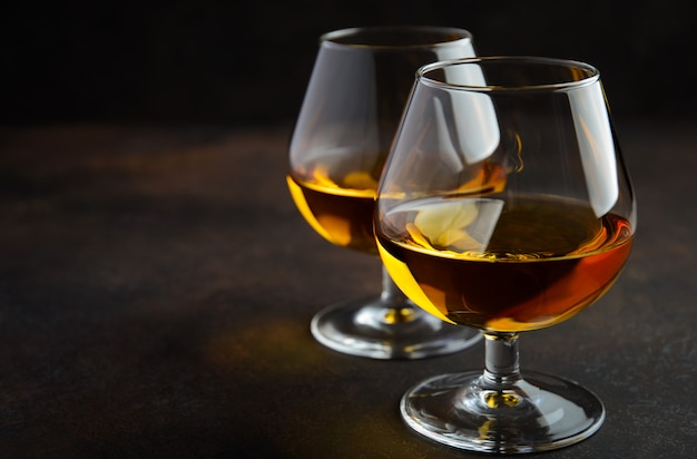 Glass of brandy or cognac on rusty wood Premium Photo