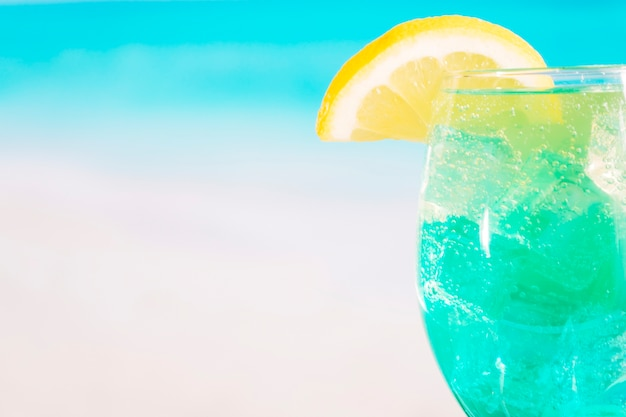 Glass of bright blue drink with lime Free Photo