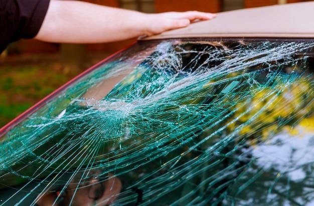Glass broken cracks splinters in front of car Premium Photo