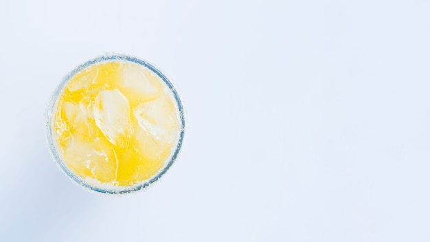 Glass of cocktail with ice cubes Free Photo