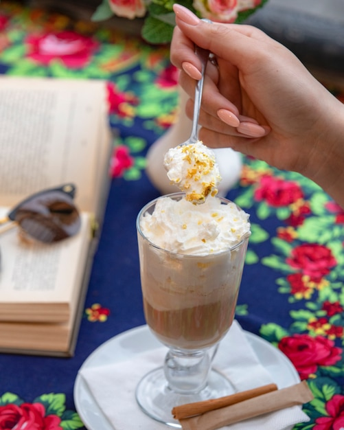 Glass of coffee latte with whipped cream Free Photo