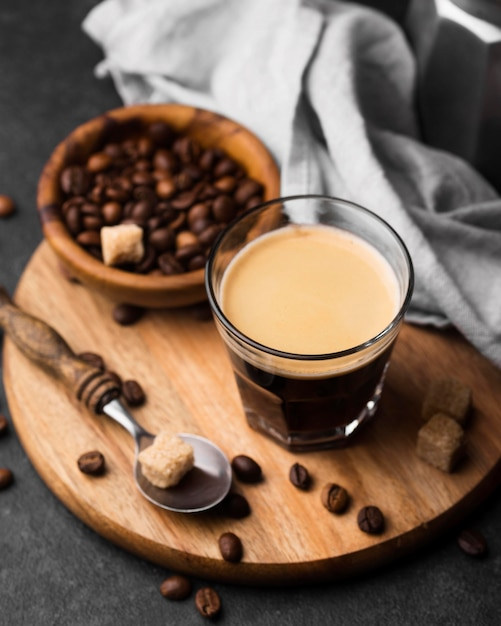 Glass of coffee on wooden board Free Photo