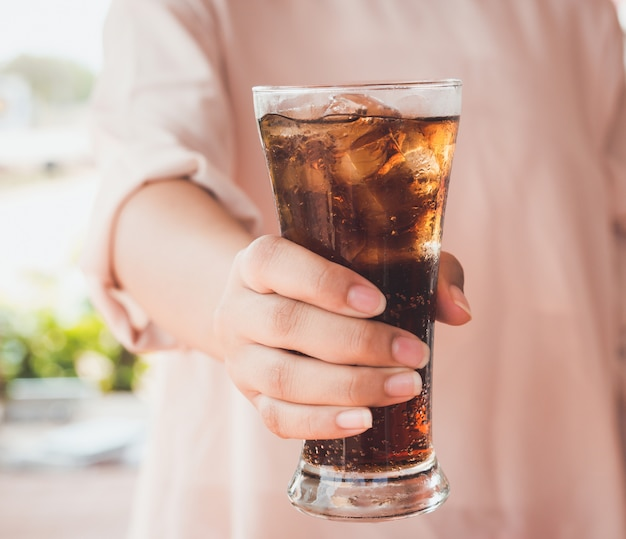 Glass of cola with ice. Premium Photo