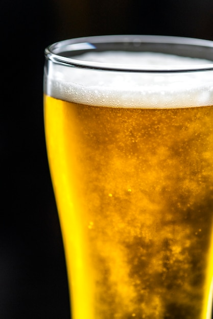 A glass of cold beer macro photography Free Photo