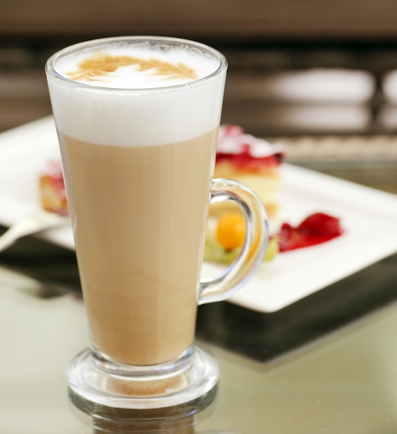 Glass of cold coffee with foam Free Photo