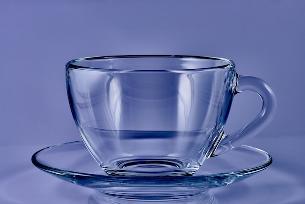 Glass cup with water on a blue background. Premium Photo