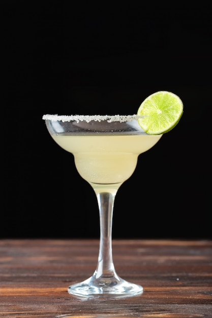 Glass of delicious alcoholic cocktail on dark background Premium Photo