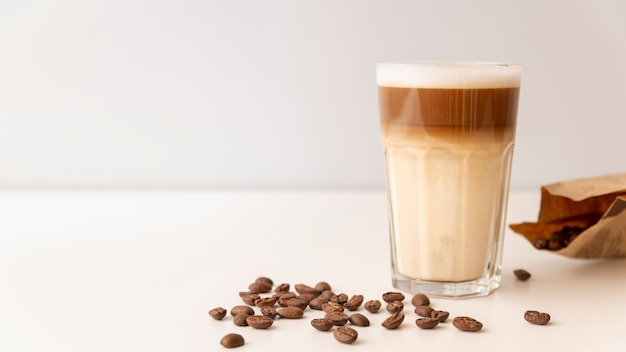 Glass filled with coffee and milk Free Photo