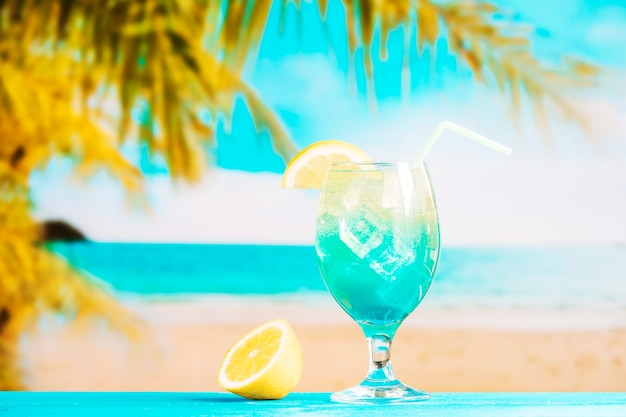 Glass of fresh blue drink with straw and sliced lime Free Photo