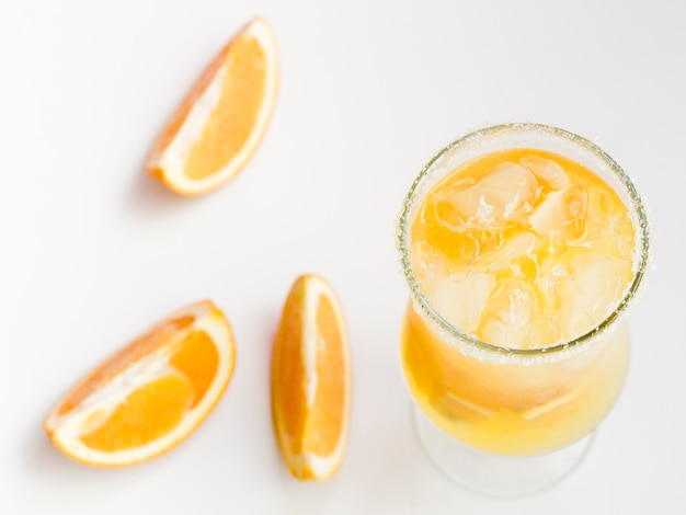 Glass of fresh cold orange cocktail with ice Free Photo