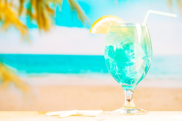 Glass of frozen blue drink with straw Free Photo