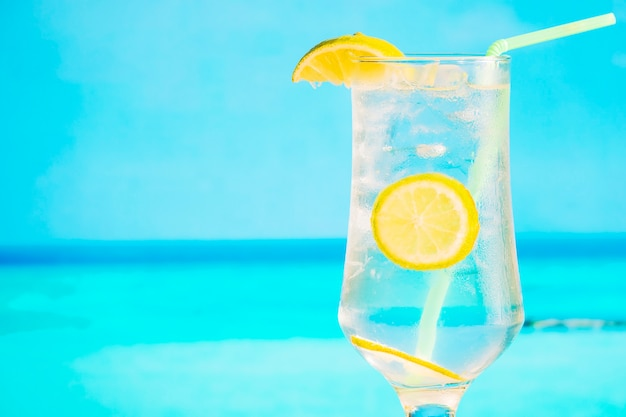 Glass of frozen drink with sliced lemon and straw Free Photo