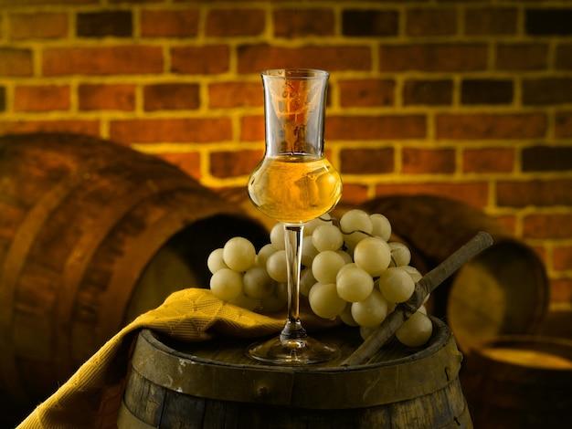 Glass of grappa in the cellar Premium Photo
