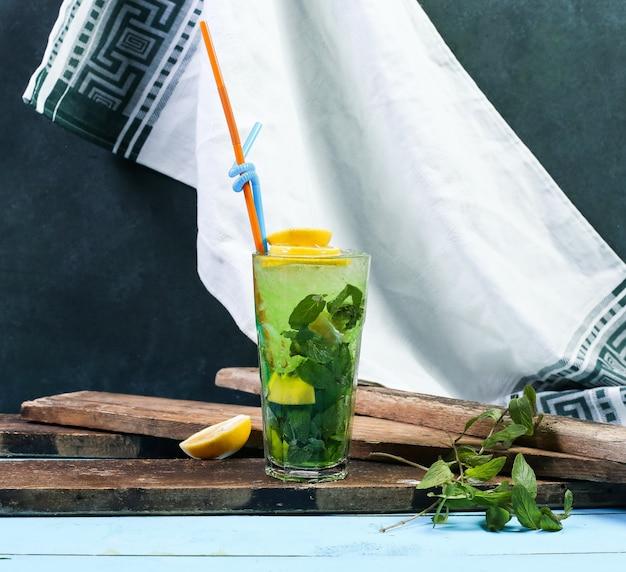 A glass of green mojito with lemon. Free Photo
