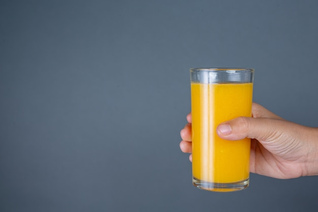 Glass handle orange juice. Free Photo