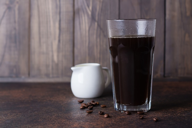 A glass of hot coffee espresso  with coffee beans Premium Photo