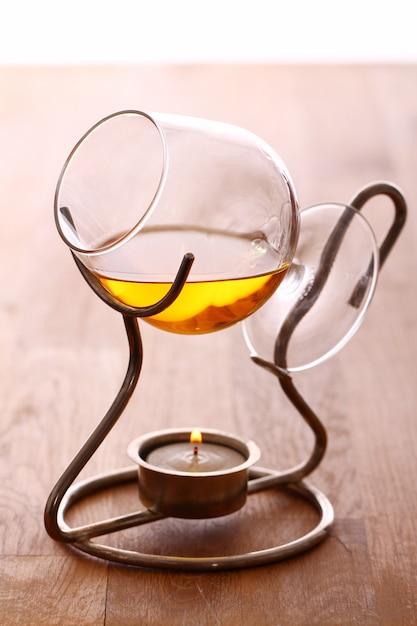 Glass of hot cognac Free Photo