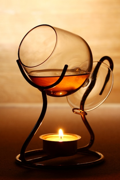 Glass of hot cognac Free Photo