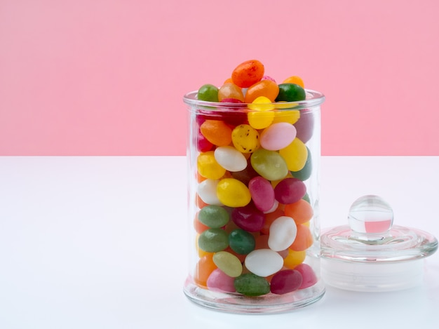 Glass jar with lid filled with colorful candies Premium Photo