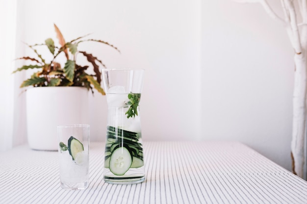 Glass and jug with refreshing water Free Photo