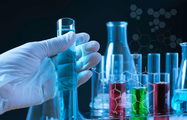 Glass laboratory chemical test tubes with liquid for analytical , medical, pharmaceutical and scientific research concept. Premium Photo