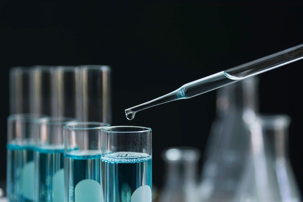 Glass laboratory chemical test tubes with liquid for analytical Premium Photo
