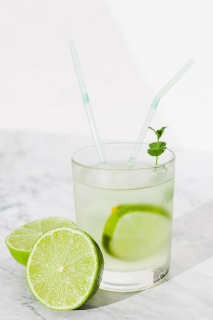 Glass of lime drink on table Free Photo