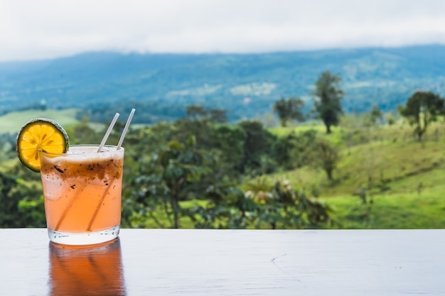 Glass of michelada with ice and lemon on the table in a jungle. costa rica gastronomy Premium Photo