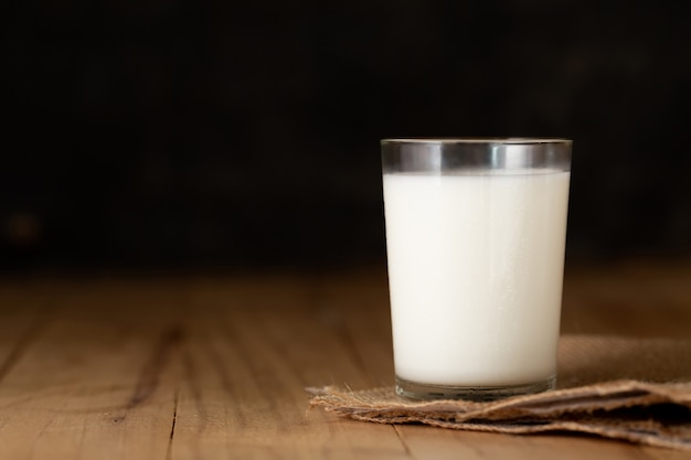 Glass of milk against Free Photo