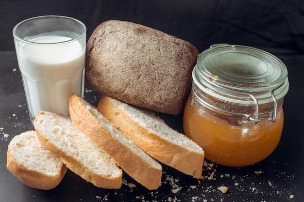 Glass of milk and bread Premium Photo