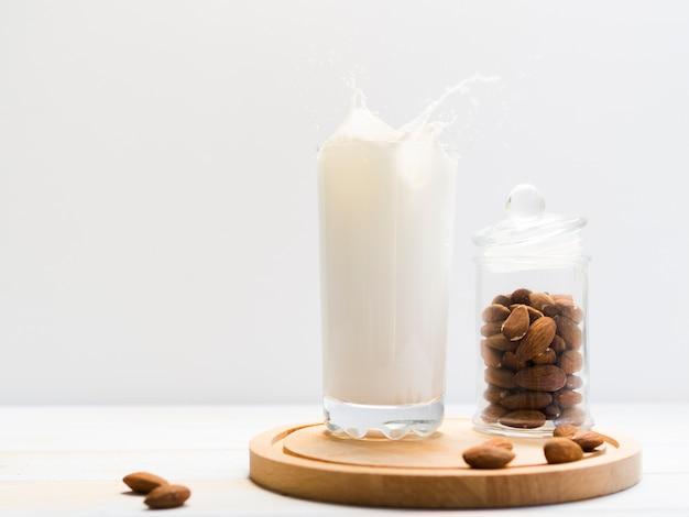 Glass of milk with almonds Free Photo